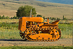 Restored tractor collection of Ron Smith along the Carson River, Nev...1941 Cletrac HG crawler tractor, orange.