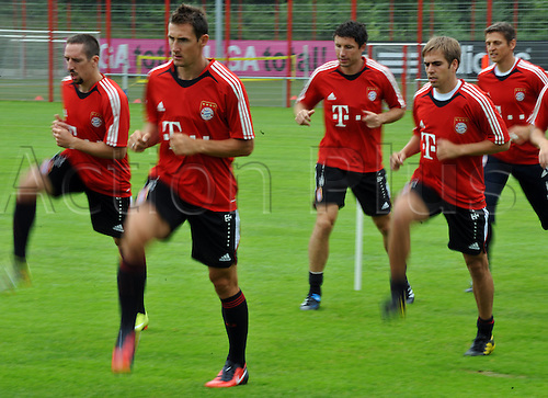 FC Bayern team members Franck Ribery (L-R), Miroslav Klose, Mark van Bommel, Philipp Lahm, Hans-Joerg Butt run during a training session on the club grounds in Munich, Germany, 2 August 2010. It is the first training in the new season. 11 of the National team players stay in the Bundesliga club team.
