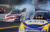Oct 4, 2013; Mohnton, PA, USA; NHRA funny car driver Cruz Pedregon (left) does a burnout alongside Ron Capps during qualifying for the Auto Plus Nationals at Maple Grove Raceway. Mandatory Credit: Mark J. Rebilas-