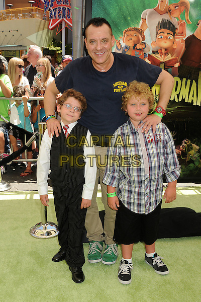 "Tom Sizemore & guests.""ParaNorman"" Los Angeles Premiere held at AMC CityWalk Stadium 19 Theatre, Universal City, California, USA..August 5th, 2012.full length t-shirt waistcoat shirt white check blue black kids children beige trousers hands on shoulders .CAP/ADM/BP.©Byron Purvis/AdMedia/Capital Pictures."