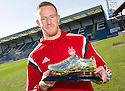 Aberdeen's Adam Rooney receives the Scottish Sun's Golden Boot Award after scoring against Dundee at Dens Park.