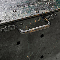 BNPS.co.uk (01202 558833)<br /> Pic: BonhamsNewYork/BNPS<br /> <br /> Holes in the crate which let the water flood in. <br /> <br /> Harry Houdini's 'trick' steel crate which he used for his daring underwater escapes has emerged for sale for £55,000. ($70,000)<br /> <br /> The illusionist would box himself into the claustrophobic 28ins by 36ins container which he had to get out of and swim to the surface.<br /> <br /> It has a solid lid which was designed to be padlocked to his body, with small holes on each side to let water gush in.<br /> <br /> But all was not as it seemed as the crate actually has a sliding trap door on the bottom he was able to get through.<br /> <br /> This crate, which was used in the 1953 film Houdini starring Tony Curtis, is going under the hammer with auctioneer Bonhams New York.