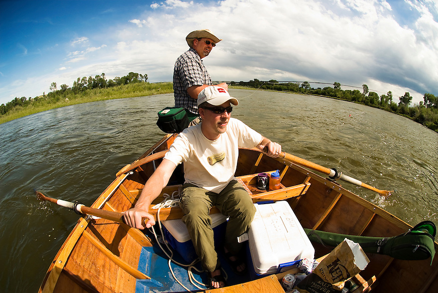 Two anglers float in a drift boat down the Madison River between Greycliff and Three Forks, Montana.