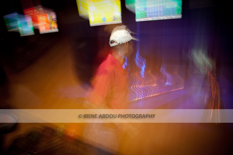 Long-exposure, abstract photograph of a man bowling at Lucky Strike Bowling Alley in Washington DC's Verizon Center.