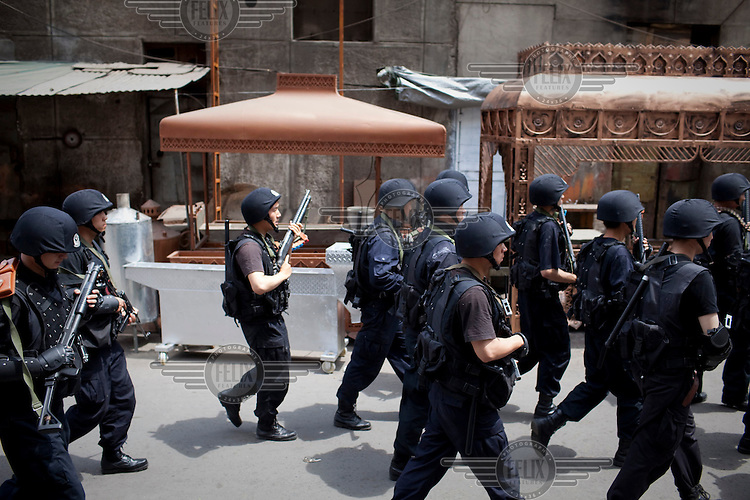 Anti-riot police conduct an operation in the Uighur district of Urumqi. Ethnic violence between the Uighur and Han Chinese people had erupted in the city a few days earlier.