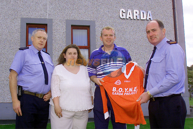 Garda Tom Connolly, Marian Horan, B.O.Y.N.E. project co-ordinator, Dennis O'Connell, teacher at St Paul's School and Inspector Gerry O'Brien..Dennis O'Connell is pictured receiving the jersey sponsored by the B.O.Y.N.E. Garda project from Inspector Gerry O'Brien.Picture: Arthur Carron/Newsfile