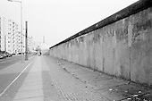 Berlin, Germany<br /> November 1, 2009<br /> <br /> The Berlin Wall still exisits in Berlin but only in a very few places. Here a small stretch of the wall is up for tourists at the Wall Museum. The peices stand where they always stood dividing the city and country. In most of Berlin shops, restaurants, office buildings, and hotels, line the streets on both side where the wall once stood. 20 years after the fall of the wall wealth, prosperity and peace exist in this place which has come to be known as one the most exciting cities in Europe.