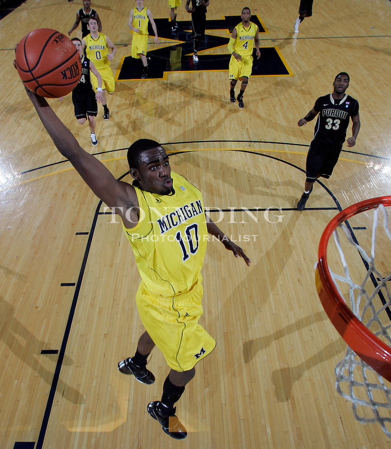 Michigan guard Tim Hardaway, Jr. (10) winds up for a dunk on a breakaway play in the second half of an NCAA college basketball game with Purdue, Tuesday, Dec. 28, 2010, at Crisler Arena in Ann Arbor, Mich. Purdue won 80-57. (AP Photo/Tony Ding)