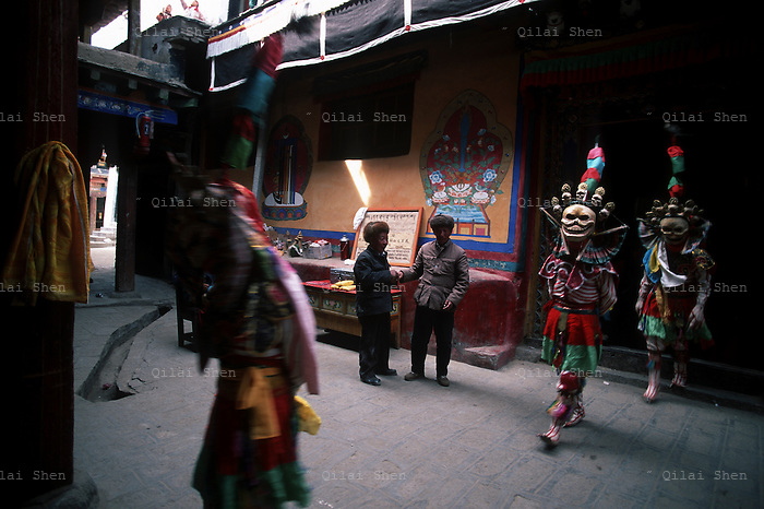 Monks dresses as skeletons walks by visitors on their way to a ceremony known as the Cham Dance at Samye Monastery, Tibet in 1999.