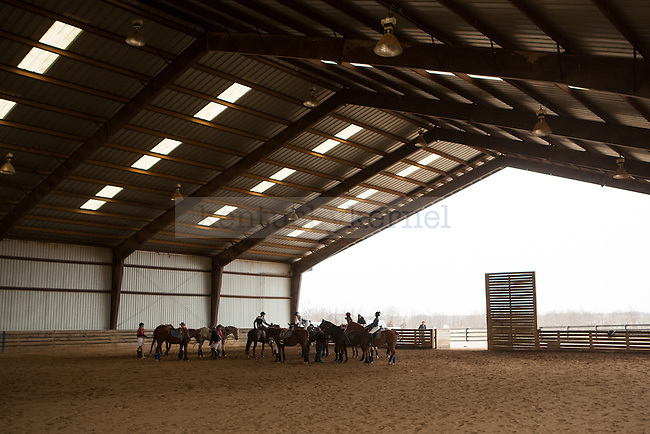 The UK and Virginia Tech polo teams receive fresh horses in between quarters at West Wind Stables on Saturday, January 31, 2015 in Lexington, Ky. Photo by Adam Pennavaria | Staff