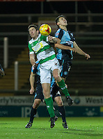 Luke O'Nien of Wycombe Wanderers and Ben Tozer of Yeovil Town battle in the air during the Sky Bet League 2 match between Yeovil Town and Wycombe Wanderers at Huish Park, Yeovil, England on 24 November 2015. Photo by Andy Rowland.