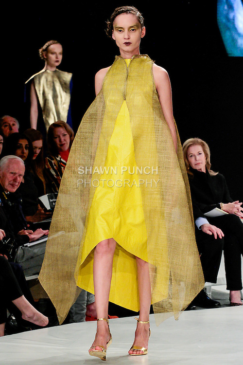 Model walks runway in an outfit by Lucy Trower, during the 2013 Pratt Institute Fashion Show, on April 25, 2013.