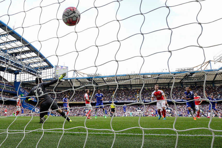 GOAL - Chelsea's Eden Hazard scores his sides second goal after Arsenal's Petr Cech is wrong footed by a deflection<br /> <br /> Photographer Craig Mercer/CameraSport<br /> <br /> Football - Barclays Premiership - Chelsea v Arsenal - Saturday 19th September 2015 - Stamford Bridge - London<br /> <br /> &copy; CameraSport - 43 Linden Ave. Countesthorpe. Leicester. England. LE8 5PG - Tel: +44 (0) 116 277 4147 - admin@camerasport.com - www.camerasport.com