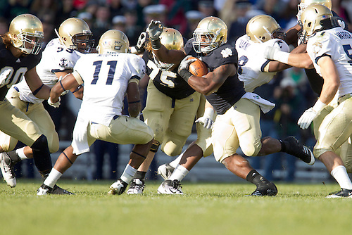 Notre Dame tailback Jonas Gray (#25) runs for yardage during second quarter of NCAA football game between Notre Dame and Navy.  The Notre Dame Fighting Irish defeated the Navy Midshipmen 56-14 in game at Notre Dame Stadium in South Bend, Indiana.