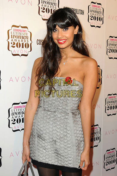 JAMEELA JAMIL.Cosmopolitan Ultimate Women Of The Year Awards, Banqueting House, Whitehall Place, London, England..November 2nd, 2010.half length black  tights grey gray dress strapless print  poppy red lipstick.CAP/CAS.©Bob Cass/Capital Pictures.
