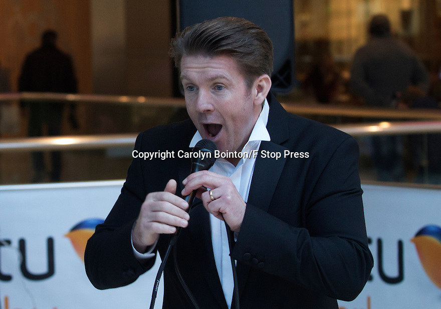 """17/01/2017<br /> ***WITH PICS and video https://youtu.be/VElv266UmeY***<br /> By Carolyn Bointon<br /> <br /> Another typical weekend busker trying to scrape a living by singing in his local shopping mall? <br /> <br /> Not exactly. <br /> <br /> Professional tenor, Jack Foley, who has performed at the Opera House in Covent Garden and appeared in numerous musicals, spends every minute of his spare time performing in town centres up and down the UK to raise money for Cancer Research UK and in just four years this talented singer has handed over more than £73,000 to the charity.<br /> <br /> The 48-year-old, who lives in Bromley, Kent with his wife Beata and 14-month-old baby, also called  Jack, has put on more than 250 impromptu shows so far since he first started busking in 201.<br /> <br /> He said he wanted to support Cancer Research UK as his uncle past away from the disease.<br /> <br /> """"It was a difficult time when my dear uncle died from cancer,"""" he said. """"And I was grateful that there are charities around to help people at these times.<br /> <br /> """"And Cancer Research UK have been really appreciative of the donations,"""" he added. """"In fact, I was invited to perform at its Mistletoe Ball held in the Dorchester Hotel at Christmas. That was a real honour.""""<br /> <br /> The talented tenor has no plans to stop his charity fundraising any time soon. """"I'm just putting together a schedule of places to visit this year and I'm happy to hear from anyone who would like me to come to their town for Cancer Research UK.""""<br /> <br /> Jack is pictured at his latest busking gig, held on Saturday in the Derby Intu Shopping Centre, where he raised another £333.<br /> <br /> <br /> ends.<br /> All Rights Reserved: F Stop Press Ltd. +44(0)1773 550665   www.fstoppress.com"""