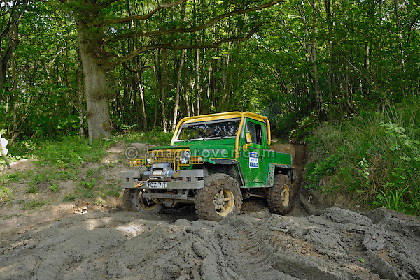 Strongly modified Land Rover 88 Lightweight competing in the ALRC National 2008 RTV Trial. The Association of Land Rover Clubs (ALRC) National Rallye is the biggest annual motor sport oriented Land Rover event and was hosted 2008 by the Midland Rover Owners Club at Eastnor Castle in Herefordshire, UK, 22 - 27 May 2008. --- No releases available. Automotive trademarks are the property of the trademark holder, authorization may be needed for some uses.