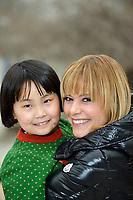 "Swiss singer and TV presenter Francine Jordi  visiting ""SOS Kinderdorf"" in Tianjin, China. With Qiu Yiyu, 8 year old. 22-Mar-2016"