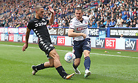 Bolton Wanderers' Andrew Taylor is tackled by Leeds United's Kemar Roofe<br /> <br /> Photographer Rachel Holborn/CameraSport<br /> <br /> The EFL Sky Bet Championship - Bolton Wanderers v Leeds United - Sunday 6th August 2017 - Macron Stadium - Bolton<br /> <br /> World Copyright &copy; 2017 CameraSport. All rights reserved. 43 Linden Ave. Countesthorpe. Leicester. England. LE8 5PG - Tel: +44 (0) 116 277 4147 - admin@camerasport.com - www.camerasport.com