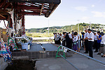 Visitors pay their respects to the 42 officials who died at  the Crisis Management Center in Minamisanriku Town, Miyagi Prefecture, Japan on 11 Sept. 2012, 18 months after the Great East Japan Earthquake and tsunamis it the Tohoku region. While other buildings such as the nearby Shizugawa municipal hospital have recently been torn down the fate of  disaster prevention center , which has become a popular pilgrimage  site with visitors from around Japan, has yet to be decided. Photographer: Rob Gilhooly