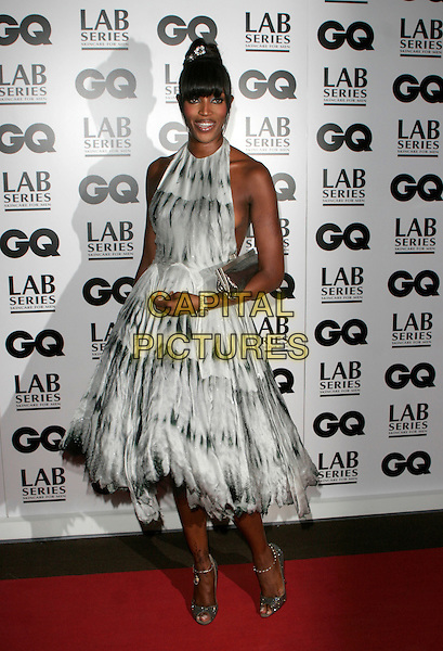 NAOMI CAMPBELL.Attending the 10th Anniversary GQ Men Of The Year Awards, Royal Opera House, Covent Garden, London, England. .full length white black grey gray dress halterneck silver sparkly shoes clutch purse .CAP/AH.©Adam Houghton/Capital Pictures