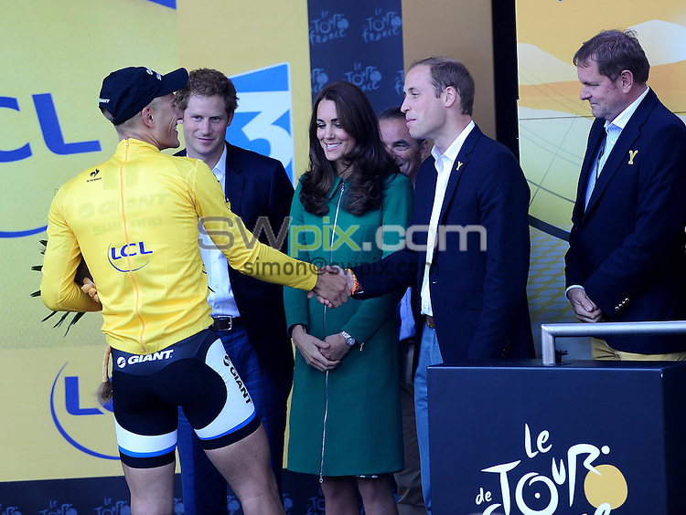 Picture by Simon Wilkinson/SWpix.com - 05/07/2014 - Cycling - Tour de France 2014 Grand Depart - Stage 1, Leeds to Harrogate - Yorkshire, England - Team Giant-Shimano's Marcel Kittel celebrates in the yellow jersey with the Duke & Duchess of Cambridge and Prince Harry after winning Stage 1 in Harrogate.