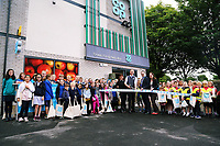(CENTRE L-R) Local Councillor Irene Mann, store manager Aled Jones, area manager Chris Ellis and Councillor Mary Sherwood, surrounded by pupils from Brynmill and Ysgol Bryn Y Mor schools