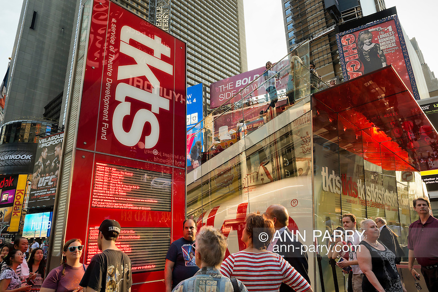 NYC, New York, U.S.  21st May 2013.  The Times Square TKTS ticket booth, behind the big red staircase, is busy during a pleasant spring day, with a high of 86ºF/32ºC in Manhattan.