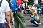 A cosplayer poses for a photographer during the Comic Market 94 (Comiket) event at Tokyo Big Sight on August 11, 2018, Tokyo, Japan. The annual event that began in 1975 focuses on manga, anime, game and cosplay. Organizers expect more than 500,000 visitors to attend the 3-day event. (Photo by Rodrigo Reyes Marin/AFLO)