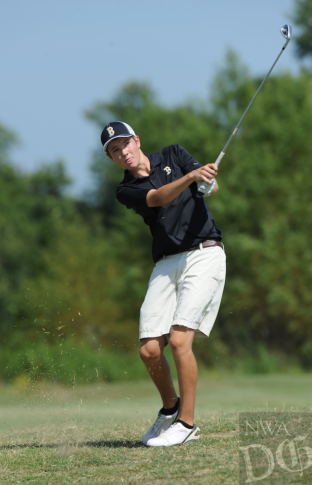 STAFF PHOTO ANDY SHUPE - Bentonville's Wade Schaller watches his second shot on the fifth hole during a match Thursday, Aug. 21, 2014, at Razorback Golf Course in Fayetteville. Visit photos.nwaonline.com to see more photographs from the match.