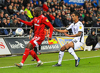29th November 2019; Liberty Stadium, Swansea, Glamorgan, Wales; English Football League Championship, Swansea City versus Fulham; Aboubakar Kamara of Fulham controls the ball despite the pressure from Kyle Naughton of Swansea City - Strictly Editorial Use Only. No use with unauthorized audio, video, data, fixture lists, club/league logos or 'live' services. Online in-match use limited to 120 images, no video emulation. No use in betting, games or single club/league/player publications