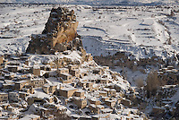 Ortahisar, Nevsehir, Cappadocia, Turkey. The village of Ortahisar.  With a hot air balloon of Kapadokya Balloons we glide over the valleys of Goreme National Park. A fresh pack of snow has turned the winter landscape into an even bigger fairy tale. Photo by Frits Meyst / MeystPhoto.com