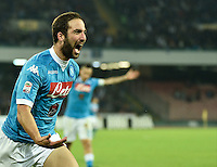 Gonzalo Higuain celebrates after scoring during the  italian serie a soccer match,between SSC Napoli and Udinese      at  the San  Paolo   stadium in Naples  Italy , November 08, 2015