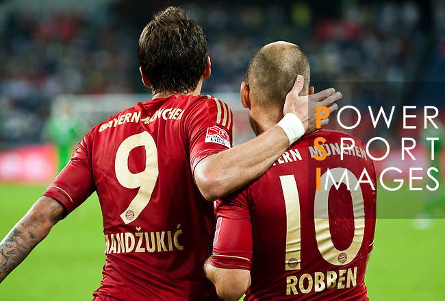GUANGZHOU, GUANGDONG - JULY 26:  Arjen Robben of Bayern Munich is congratulated by Mario Mandzukic after scoring during a friendly match against VfL Wolfsburg as part of the Audi Football Summit 2012 on July 26, 2012 at the Guangdong Olympic Sports Center in Guangzhou, China. Photo by Victor Fraile / The Power of Sport Images