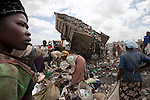 2013 - Dandora dumpsite, Nairobi, Kenya - Kenyan scavengers dig for items to sell and food waste to eat at the Dandora dumpsite, one of the largest and most toxic in Africa. Located near slums in the east of the Kenyan capital Nairobi, the open dump site was created in 1975 and covers 30 acres. The site receives 2,000 tonnes of unfiltered garbage daily, including hazardous chemical and hospital wastes. It is a source of survival for many people living in the surrounding slums, however it also harms children and adults' health in the area and pollutes the Kenyan capital. Photo credit: Benedicte Desrus