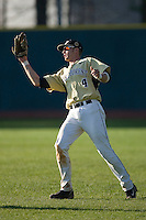Right fielder Evan Ocheltree #4 of the Wake Forest Demon Deacons catches a fly ball at Jack Coombs Field March 29, 2009 in Durham, North Carolina. (Photo by Brian Westerholt / Four Seam Images)