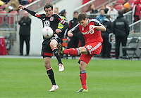 06 October 2012: D.C. United midfielder/forward Chris Pontius #13 and Toronto FC defender Darren O'Dea #48 in action during an MLS game between D.C. United and Toronto FC at BMO Field in Toronto, Ontario..D.C. United won 1-0..