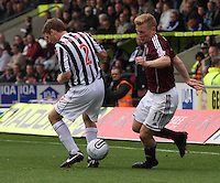 Andrew Driver beats David van Zanten in the St Mirren v Heart of Midlothian Clydesdale Bank Scottish Premier League match played at St Mirren Park, Paisley on 15.9.12.
