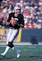 Oakland Raiders Jim Plunkett(16) in action during a game from the 1982 season. Jim Plunkett played for 15 years  with three different teams.David Durochik/SportPics