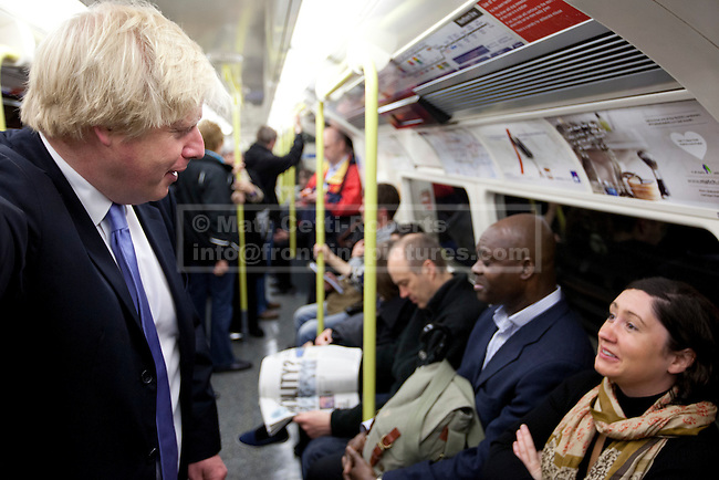 03/05/2012. LONDON, UK. London Mayor Boris Johnson talks to a member of the public on the London Underground as he travels on the Northern Line after casting his vote in the 2012 mayoral and council elections in London today (03/05/12). Photo credit: Matt Cetti-Roberts
