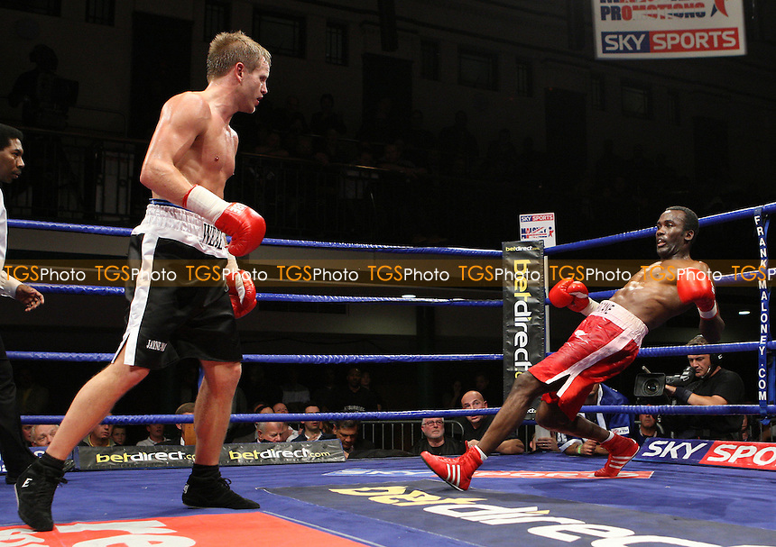 Gilbert Eastman (Battersea, red shorts) underwent surgery to remove a blood clot from his brain after a defeat by Sam Webb (Chislehurst, black shorts) in a Light-Middleweight bosing contest at York Hall, Bethnal Green, promoted by FTM Sports/Maloney Promotions -  17/10/08 - MANDATORY CREDIT: Gavin Ellis/TGSPHOTO - Self billing applies where appropriate - Tel: 0845 094 6026