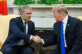 US President Donald J. Trump (R) shakes hands with the President of Colombia Ivan Duque (L) during their meeting in the Oval Office of the White House in Washington, DC, USA, 13 February 2019. President Trump and President Duque are meeting to discuss economic policies, combatting narcotics and the current situation in Venezuela.<br /> Credit: Michael Reynolds / Pool via CNP