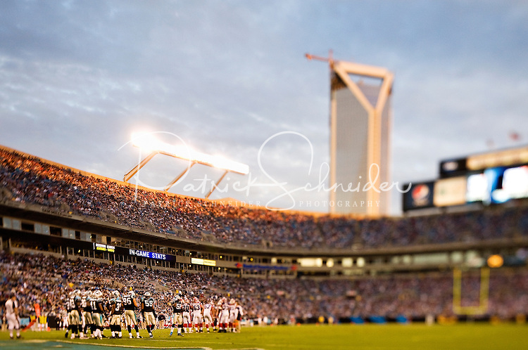 Crowds fill the stands under the downtown Charlotte skyline at Bank of America Stadium in Charlotte, NC. Photo from the Carolina Panthers' 20-9 loss to the Buffalo Bills in Charlotte on Sunday, Oct. 25, 2009. Professional American NFL football team The Carolina Panthers represents North Carolina and South Carolina from its hometown of Charlotte, NC. The Carolina Panthers are members of the NFL's National Football Conference South Division. The Charlotte professional football team began playing in Charlotte in 1995 as an expansion team.  The Carolina Panthers play in Bank of America Stadium, formerly known as Carolinas Stadium and Ericsson Stadium.