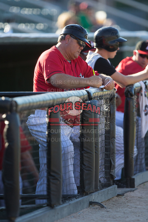 Kannapolis Intimidators manager Tommy Thompson (39) makes some notes during the game against the Asheville Tourists at Intimidators Stadium on June 28, 2015 in Kannapolis, North Carolina.  The Tourists defeated the Intimidators 6-4.  (Brian Westerholt/Four Seam Images)