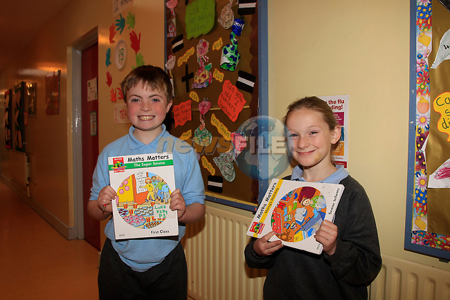 Luke Kelly and Donna Ward with there math books for math week in St Itas School.<br /> Picture: Fran Caffrey www.newsfile.ie