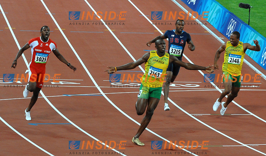 Usain Bolt wins (3rd R) Men's 100m race with new world record 9.69.<br /> Form L To R, Richard Thompson Trinidad Silver Medal, Usain Bolt, Darvis Patton Usa, Michael Frater Jamaica<br /> Usain Bolt vince i 100 metri con il nuovo record del mondo<br /> National Stadium - Bird Nest<br /> Pechino - Beijing 16/8/2008 Olimpiadi 2008 Olympic Games<br /> Foto Andrea Staccioli Insidefoto