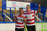 Dan Bennett of Kingstonian & Fabio Saraiva of Kingstonian celebrate the third goal during Macclesfield Town vs Kingstonian, Emirates FA Cup Football at the Moss Rose Stadium on 10th November 2019