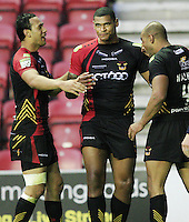 PICTURE BY CHRIS MANGNALL /SWPIX.COM...Rugby League - Super League  - Wigan Warriors v Bradford Bulls - DW Stadium, Wigan, England  - 29/06/12... Bradford's Karl Pryce congratulated by Keith Lulia (L) and Chev Walker (R) for scoring the last try