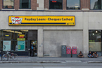A Money Mart office is seen in Winnipeg, Manitoba, Friday August 14, 2015. Money Mart offers various financial service including Payday loans, cheque cashing, easytax, currency exchange, electronic bill payments, titanium cards and Western union transfer.