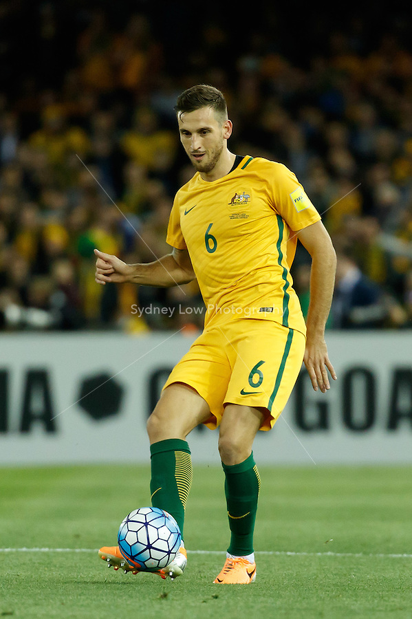 October 11, 2016: MATTHEW SPIRANOVIC (6) of Australia passes the ball during a 3rd round Group B World Cup 2018 qualification match between Australia and Japan at the Docklands Stadium in Melbourne, Australia. Photo Sydney Low Please visit zumapress.com for editorial licensing. *This image is NOT FOR SALE via this web site.